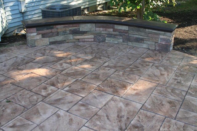 seating wall on stamped concrete patio