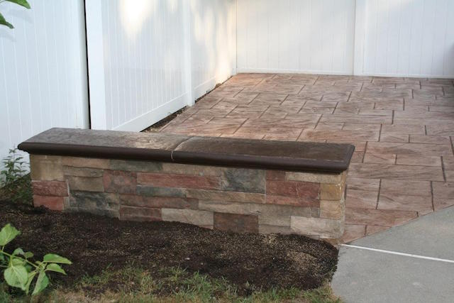 retaining wall on stamped concrete patio