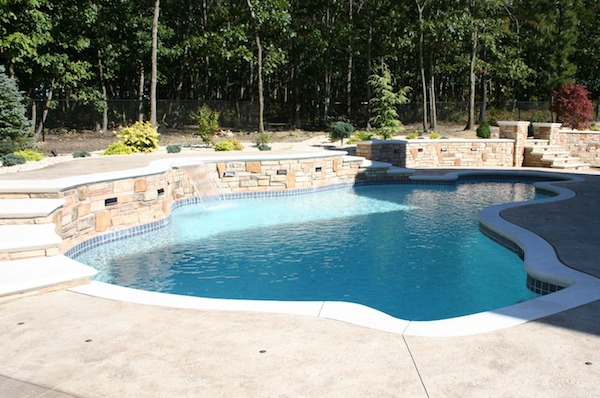 poolscape with 2 sets of outdoor stairs