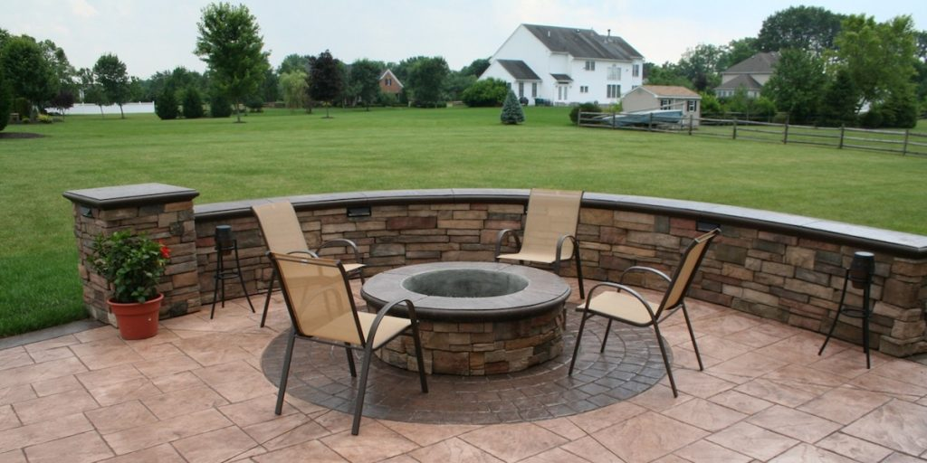 custom fire pit, stamped concrete, seating wall