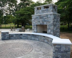 Custom Outdoor Fireplace Wall Seating with Circle Design