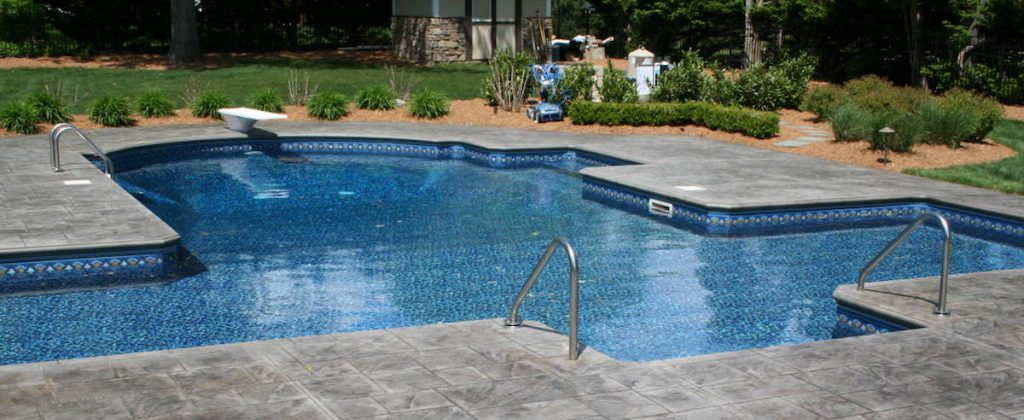pool patio with stamped concrete