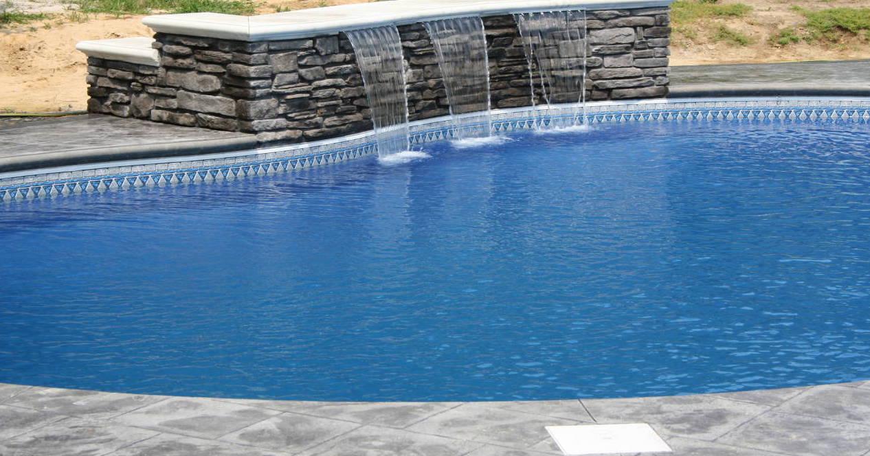 Stone Waterfall Into Pool
