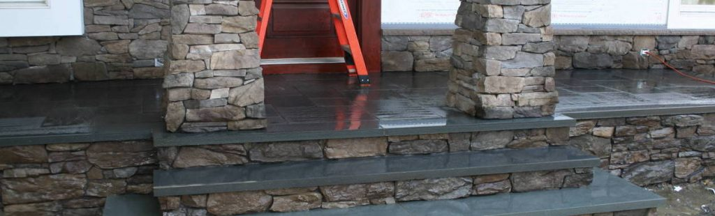custom stone stairs with bluestone flooring