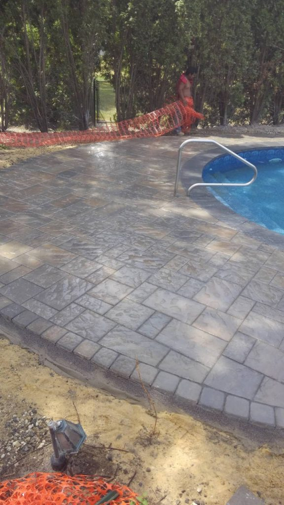 Wet Stone Paver Pool Patio