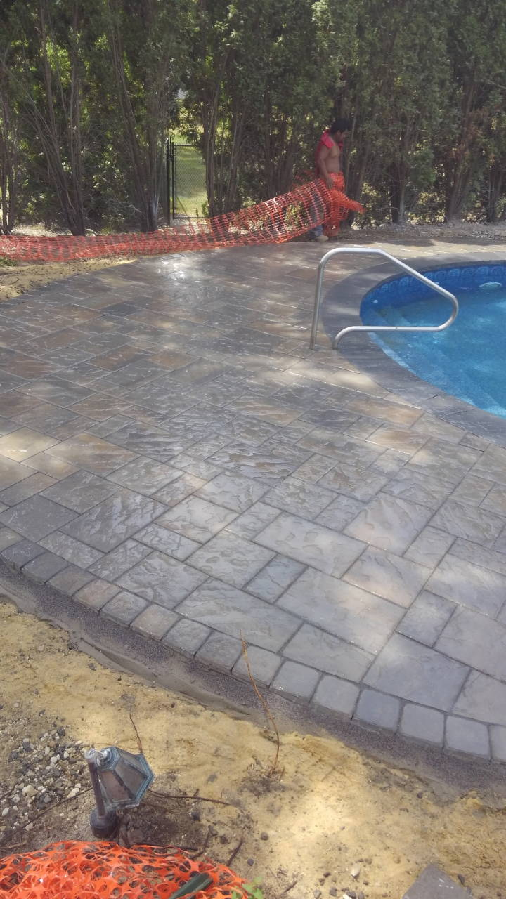Wet Stone Paver Pool Patio
