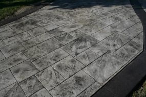Gray and Black Stamped Concrete Driveway with random slate pattern