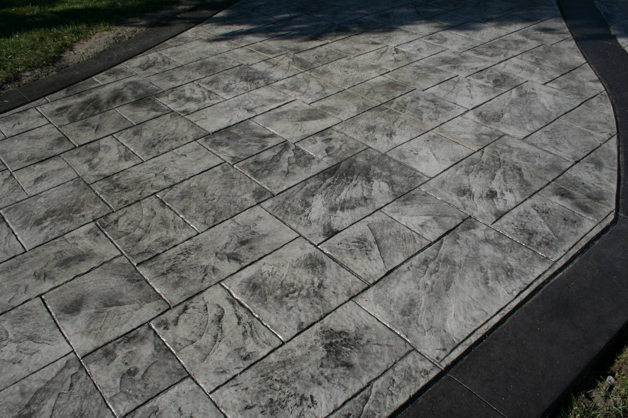 Gray and Black Stamped Concrete Slate Pattern Driveway