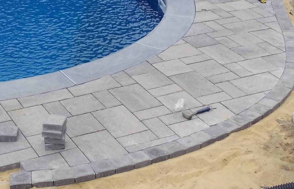Installing a paver pool patio in Howell NJ