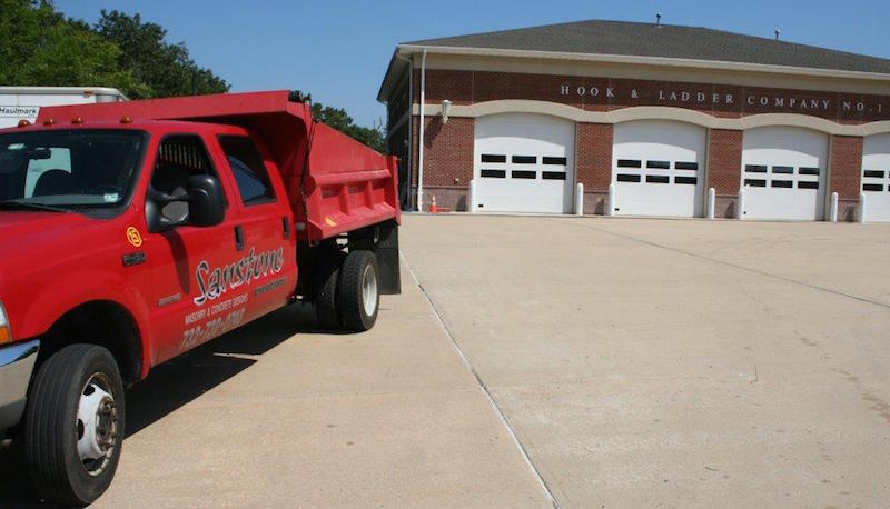 commercial masonry concrete services - firehouse driveway shown