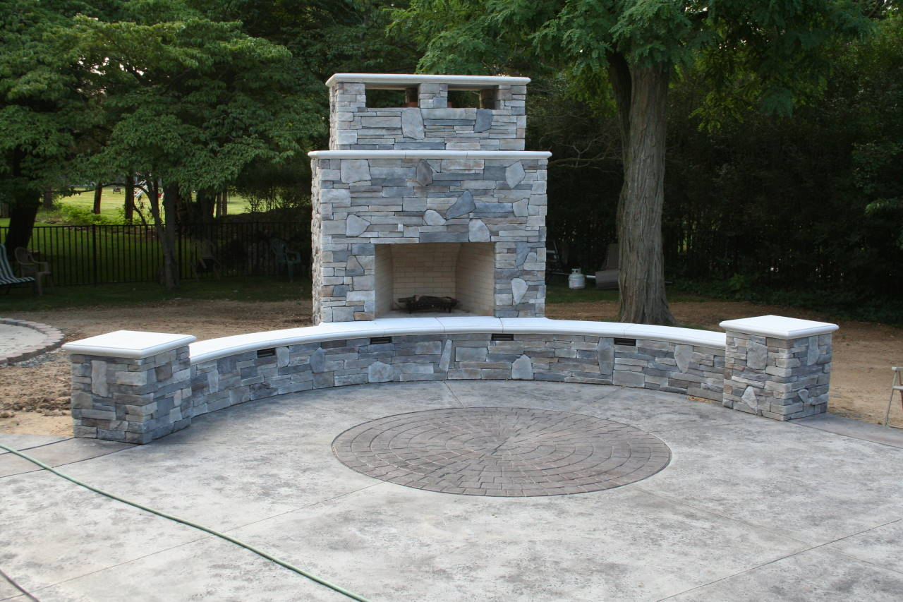 Sanstone Creations Outdoor Fireplace with Sitting Area